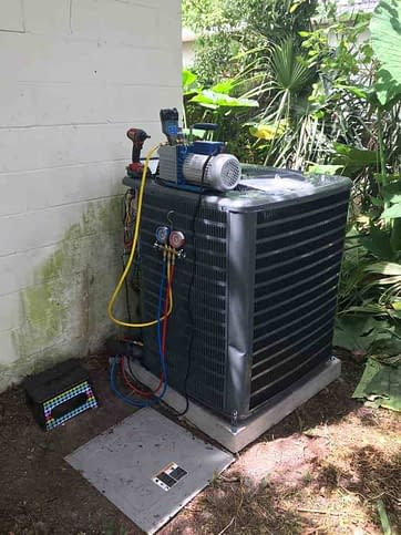 Goodman Condenser Getting Vacuumed By Florida Cooling Store In Jacksonville, FL